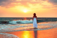 Alone on the beach. Alone attractive woman on the beach at the sunset. Sri Lanka Stock Photo