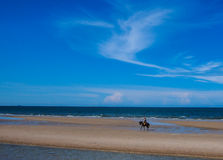 Alone and beach. Alone on beach and blue sky Stock Photos