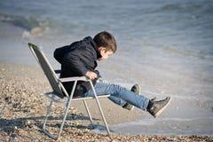 Alone, Beach, Boy royalty free stock image