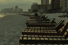 Panama City Beach Alone beach chairs water design ripples beach reflection religion foggy stock photos