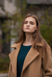 Alone beautiful girl in an autumn coat. stock images