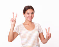 Alone beautiful girl with two winning sign Royalty Free Stock Photography