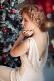 Alone beautiful woman near Christmas tree Royalty Free Stock Photo