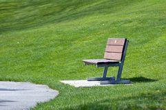 Alone bench. Close to path in park Royalty Free Stock Photo