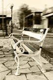 Alone bench on the park.antique metal bench Royalty Free Stock Image
