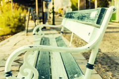 Alone bench on the park.antique metal bench Royalty Free Stock Photos