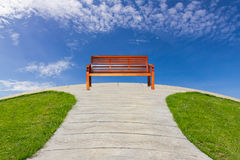 Alone bench in pathway Royalty Free Stock Image