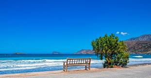 Alone bench on sea shore Royalty Free Stock Photos