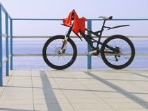 Alone bicycle at the seafront fence in sunny day Stock Photo