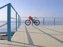 Alone bicycle at the seafront fence in sunny day Royalty Free Stock Photography