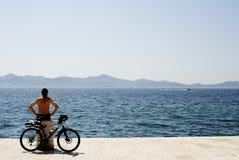 Alone biker Stock Image