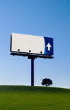 Alone billboard in a green mea Stock Photo