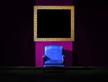 Alone blue chair with picture frame Royalty Free Stock Image
