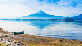 alone boat mooring on ground at side of lake kawaguchi on morning time with fuji mountain background stock photo