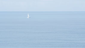 Alone boat on the ocean. An alone boat on the Atlantic ocean Royalty Free Stock Image