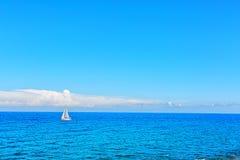 Alone boat in the ocean Stock Photo