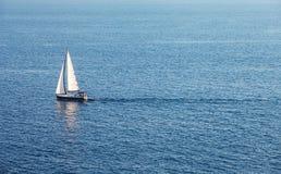 Alone boat in the ocean Stock Image
