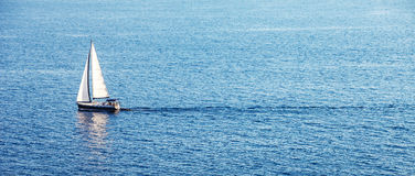 Alone boat in the ocean Stock Photos