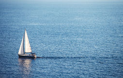 Alone boat in the ocean Stock Photography