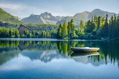 Free Alone Boat On Empty Mountain Lake Strbske Pleso In National Park High Tatra, Slovakia, Europe. Original Wallpaper With Soft Colors Stock Photos - 177971993
