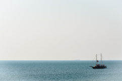 The alone boat in a quiet sea. Alone boat in a quiet sea Royalty Free Stock Photo