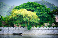 Alone Boat in Tam Coc wharf Stock Photography