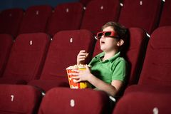 Alone boy at the cinema Stock Image