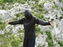 Alone boy need break free. Boy need free on mountain rock Royalty Free Stock Photos