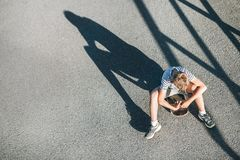 Free Alone Boy Without Friends Sits On Skateboard. Child Loneliness C Royalty Free Stock Image - 116870916