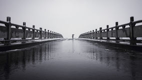 Alone in Bridge with snow Royalty Free Stock Photo