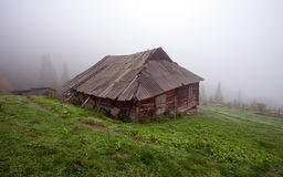 Alone cabin in the woods.  stock photography