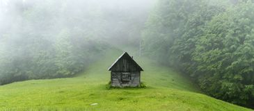 Alone cabin in the woods. High resolution panorama. Landscape photography royalty free stock photo