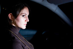 Alone in car. Woman alone sitting inside a car at night Stock Images
