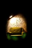 Alone chair in dark room. Under light Royalty Free Stock Photo