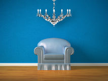 Alone chair and silver chandelier Royalty Free Stock Photography