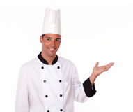 Alone chef holding up his left hand Royalty Free Stock Images