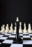 Alone chess king in front of enemy team. Unequal battle Royalty Free Stock Images