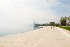 Alone in Chicago. Alone man is walking by Lake Shore Drive, Chicago on a foggy day Stock Photo