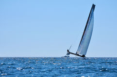 Alone crew catamaran Stock Images