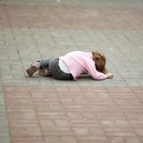 Alone crying girl lying on asphalt Stock Photo