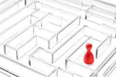 Alone in crystal maze. Red gaming piece alone in crystal maze Stock Photos