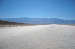 Alone in death valley. Shot taken in death valley, walking on salt flat Stock Images