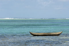 Alone dugout canoe Royalty Free Stock Image