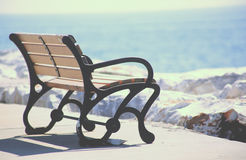Alone an empty bench. An empty bench on the beach Stock Photography