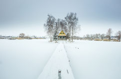 Alone farm house in winter day Stock Images