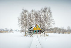 Alone farm house in winter day. In Ukraine Royalty Free Stock Image