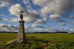 Alone in a field. Abandoned calvary middle of a field in autumn day Royalty Free Stock Photo