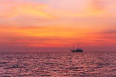 Alone fisherman boat in calm sea at sunset in the evening. Andaman sea, Thailand. Seascape Royalty Free Stock Photos