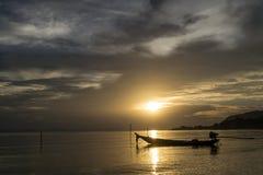 Alone Fishing boat. Beneath the sunset Stock Photos
