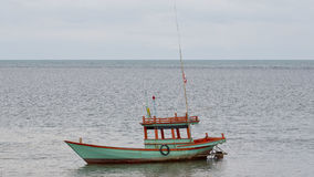 Alone Fishing Boat in a sea. Stock Image